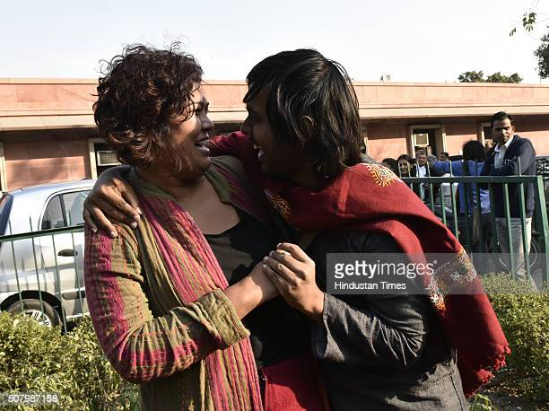 Indian gay rights activists hug each other outside the Supreme Court as it agreed to refer a curative petition challenging Section 377 of the Indian...