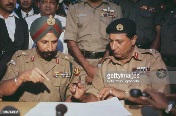 Indian general Jagjit Singh Aurora pictured on left pointing to the surrender documents as he instructs Pakistan Army general Amir Abdullah Khan...