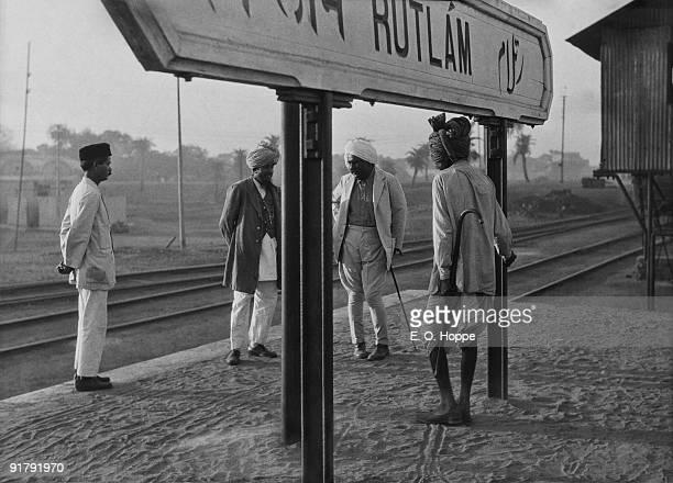 Indian gentlemen chatting at Rutlam Railway Station in Madhya Pradesh, India, 1929.