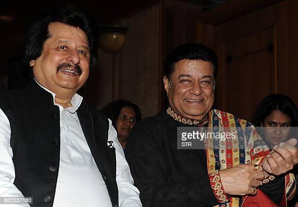 Indian ghazal singer Pankaj Udhas and bhajan singer Anup Jalota look on during a promotional event in Mumbai on late January 18 2017 / AFP / STR