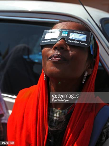 Indian girl observes the rare Annular Solar Eclipse at the central stadium on January 15 2010 in Thiruvananthapuram Kerala South IndiaThis rare...