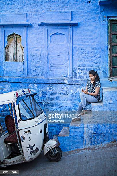 indian girl sending a message in the street of jodhpur - jodhpur stock pictures, royalty-free photos & images