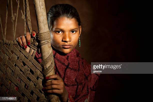 indian girl standing behind a hand woven jute cot - rural scene stock pictures, royalty-free photos & images