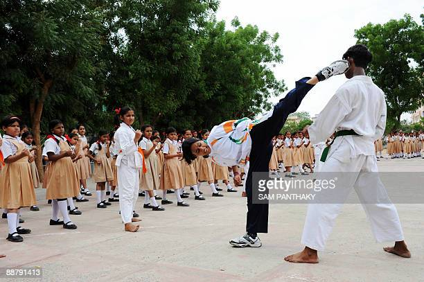 Indian girls at St Xavier's High SchoolHansol's primary school learn basic martial arts by watching and imitating professionals in Ahmedabad on July...