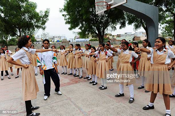 Indian girls at St Xavier's High SchoolHansol's primary school learn basic martial arts in Ahmedabad on July 2 2009 A standard XII school girl was...