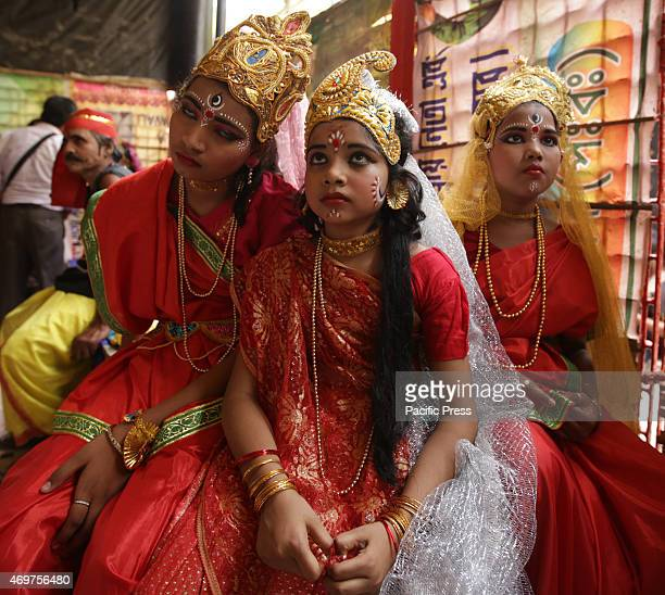 Indian girls dress as Radha at the traditional Gajan Festival Hundreds of Hindu devotees attend the Chadak ritual held to worship the Hindu deity of...