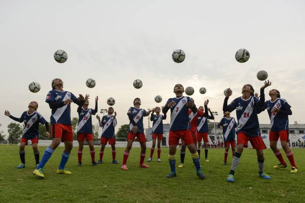 Indian girls players of the Youth Football Club practice at Rurka Kalan village some 40 km from Jalandhar on June 9 2018
