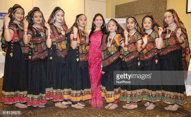 Indian girls representing the state of Rajasthan pose for a photo with their teacher before competing in a traditional Indian folk dance competition...