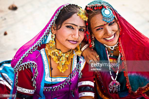 indian girls smiling in rajasthan desert - indian beautiful girls stock photos and pictures