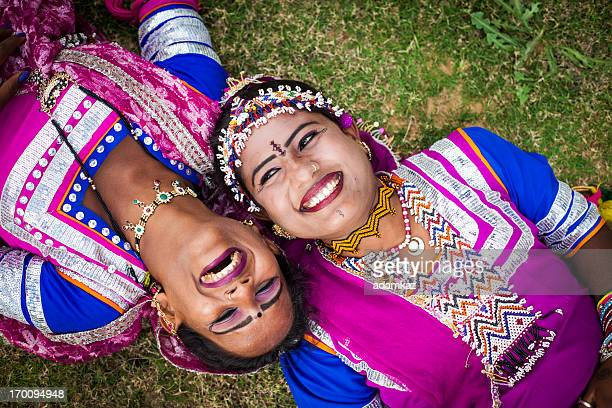 indian girls smiling on grass - indian beautiful girls stock photos and pictures