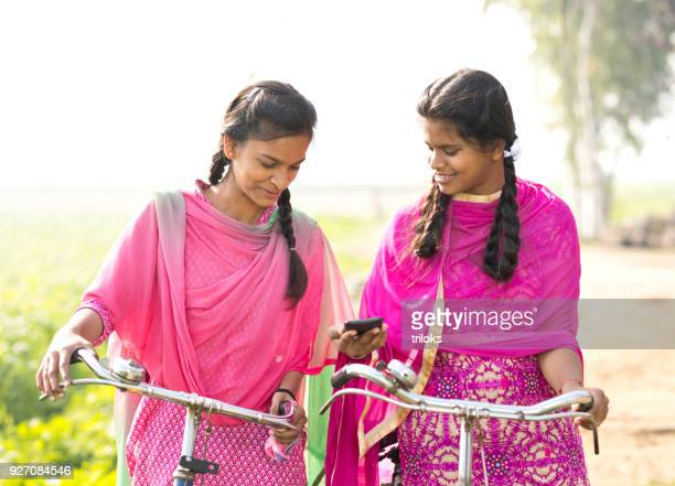 Indian girls with bicycle and mobile phone