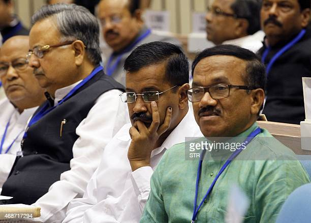 Indian Goa Chief Minister Laxmikant Parsekar Delhi Chief Minster Arvind Kejriwal and Chhatisgarh Raman Singh listen to a speech during the Joint...