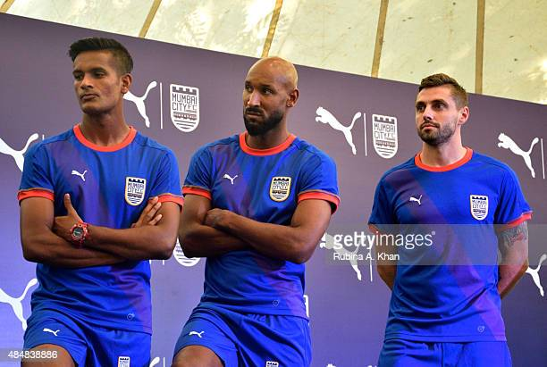 Indian goalie Subrata Paul French footballer Nicolas Anelka and Brazilian footballer Andre Moritz at the unveiling of the new Puma Mumbai City FC...
