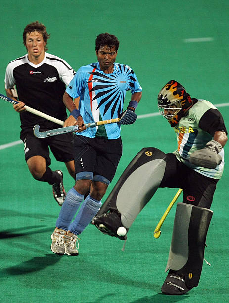 Indian goalkeeper Baljit Singh blocks an attempt at goal as New Zealand opponent Simon Child looks on during the opening match of the fournation...