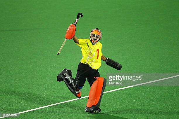 Indian goalkeeper Bharat Kumar Chetri celebrates after India won a penalty shoot outduring the Men Semifinals Match between England and India at...