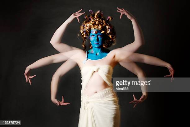 indian goddess: blue-faced mystical creature with multiple arms - hindu god stock pictures, royalty-free photos & images