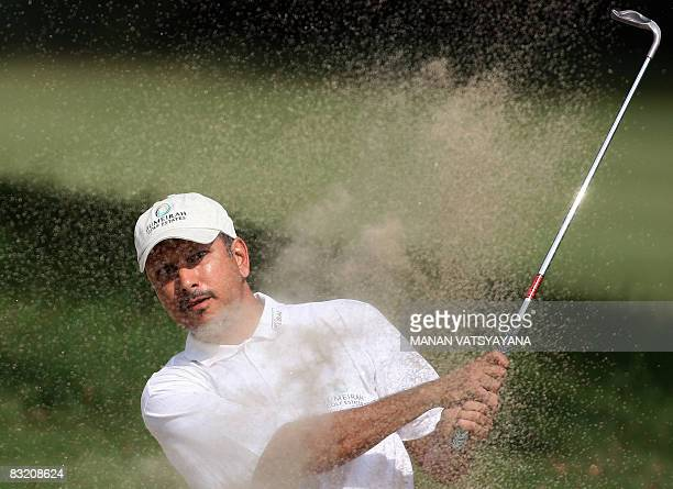 Indian golfer Jeev Milkha Singh hits the ball out of the bunker on the eighth hole during the second round of the Hero Honda Indian Open at the Delhi...