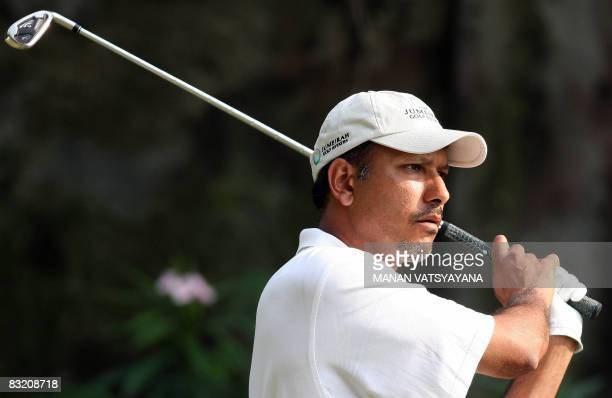 Indian golfer Jeev Milkha Singh tees off during the second round of the Hero Honda Indian Open at the Delhi Golf Club in New Delhi on October 10,...
