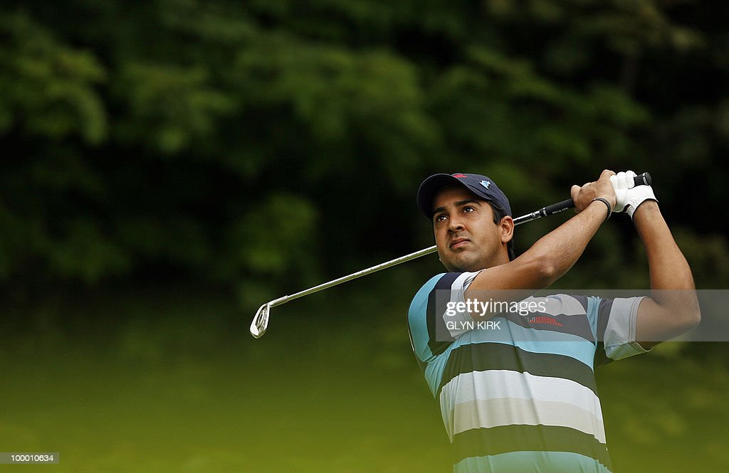 Indian golfer Shiv Kapur watches his drive from the 2nd tee on the first day of the PGA Championship on the West Course at Wentworth, central England on May 20, 2010.