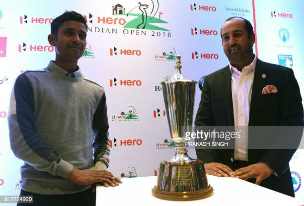 Indian golfers Rashid Khan and Shiv Kapur pose with the Hero Indian Open trophy during a press conference for 'India Open 2018' golf tournament in...