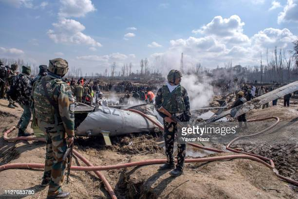 Indian government and military forces attend to the scene of a crashed Indian Air Force aircraft on February 27 2019 in Budgam west of Srinagar the...