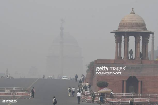 TOPSHOT Indian government department buildings are shrouded by heavy smog in New Delhi on November 16 2017 Delhi is now the world's most polluted...