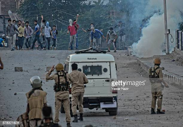 Indian government forces and Kashmiri Muslims throw stones at each other during a curfew following violence that has left over 45 people dead and...