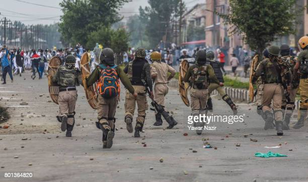 Indian government forces chase away Kashmiri protesters during an anti India protest on Eidulfitr a festival of Muslims on June 26 2017 in Srinagar...