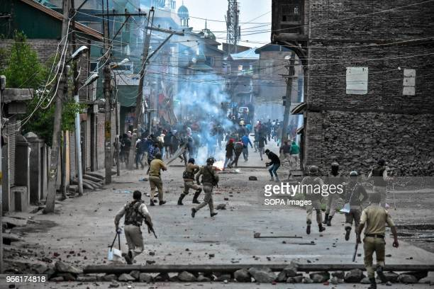 Indian government forces chase Kashmiri protesters during clashes in Srinagar Indian administered Kashmir Fierce clashes broke out between government...