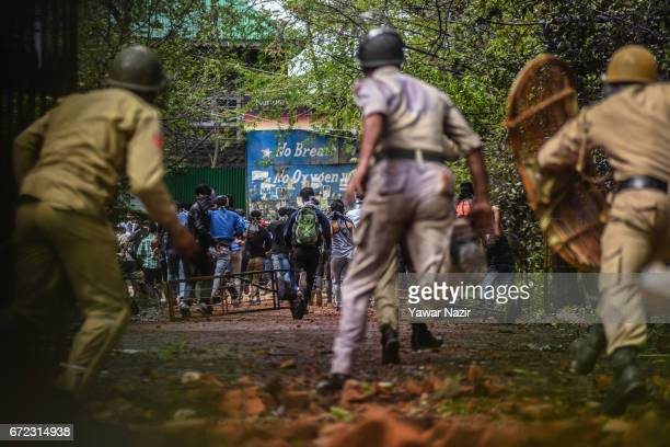 Indian government forces chase Kashmiri students during a protest against the attack by Indian government forces on students on April 24 in Srinagar...