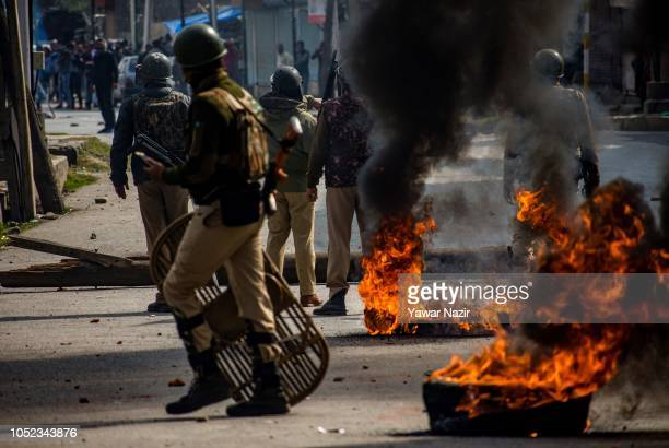 Indian government forces clash with Kashmiri protesters near the site after a gun battle between Indian government forces and Kashmiri rebels on...