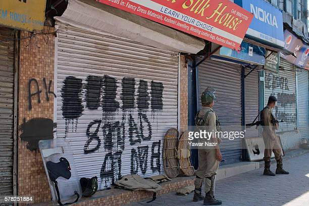 Indian government forces guard in front the shops where the anti Indian graffiti was effaced by Indian government forces in the city center during a...