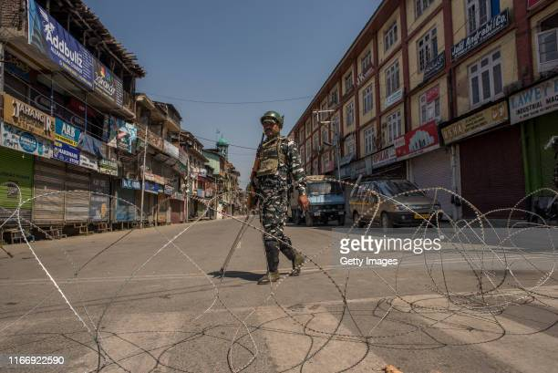 Indian government forces guard the closed commercial hub in the city center during curfew like restrictions on September 09, 2019 in Srinagar, the...