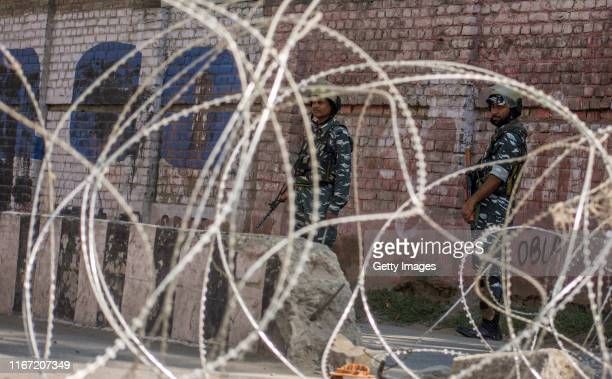 Indian government forces guard the deserted city center during curfew like restrictions, on September 10, 2019 in Srinagar, the summer capital of...