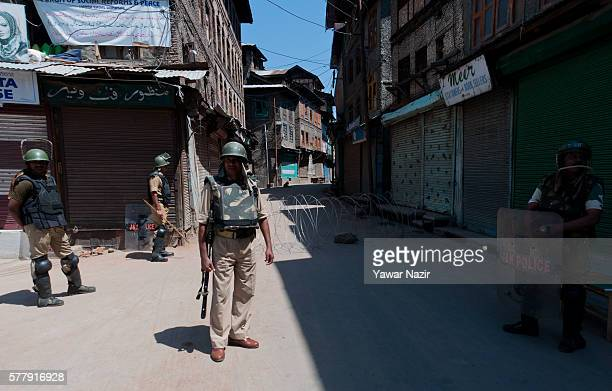 Indian government forces guard the old city during a curfew following violence that has left over 45 people dead and thousands injured on July 20...