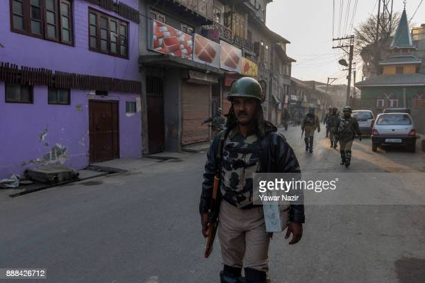 Indian government forces patrol the deserted streets to thwart protest rallies by kashmiri Muslims against United States President Donald Trump's...