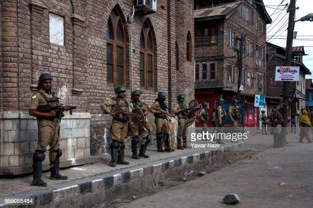 Indian government forces point their guns at Kashmirs carrying the body of Adil Ahmed Yadoo a civilian mown down by Indian police armored vehicle...