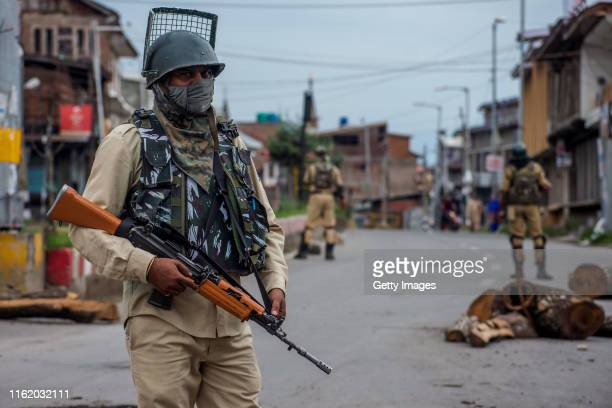 Indian government forces stand alert amid curfew like restrictions in the old city after Indian authorities revoked Article 370 and Article 35A on...