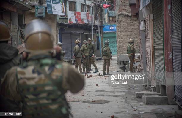 Indian government forces stand guard after clashes between Kashmiri protesters outside the house of Yasin Malik leader of the Kashmiri resistance...