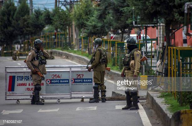 Indian government forces stand guard amid curfew like restrictions in the old city after Indian authorities revoked Article 370 and Article 35A on...