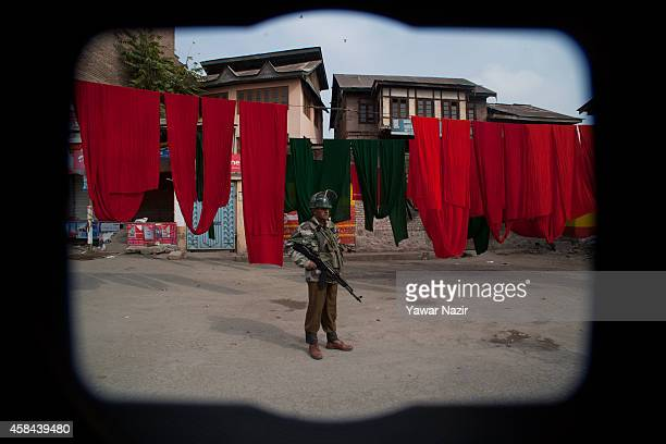 Indian government forces stand guard on a road during a curfew two days after Indian army killed two civilians on November 05 2014 in Srinagar the...