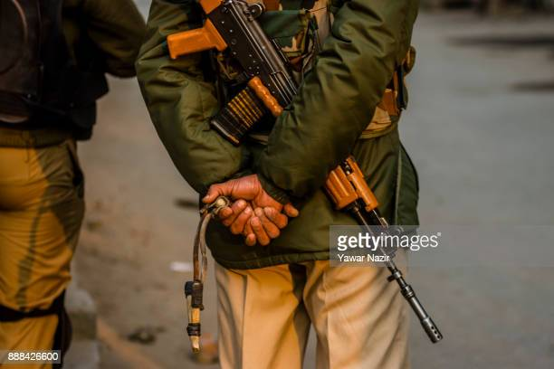Indian government forces stand guard with their rifles and catapults to thwart protest rallies by kashmiri Muslims against United States President...