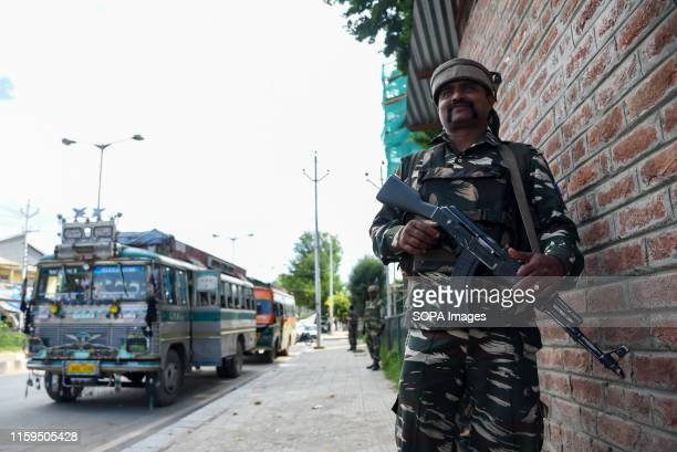 Indian government forces stand on guard as Additional Indian Troops arrive in Srinagar Fear and confusion have gripped residents in India...