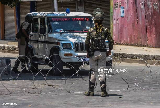 Indian government forces stop an ambulance during a curfew on the the first death anniversary of Burhan Wani a young rebel commander on July 8 2017...