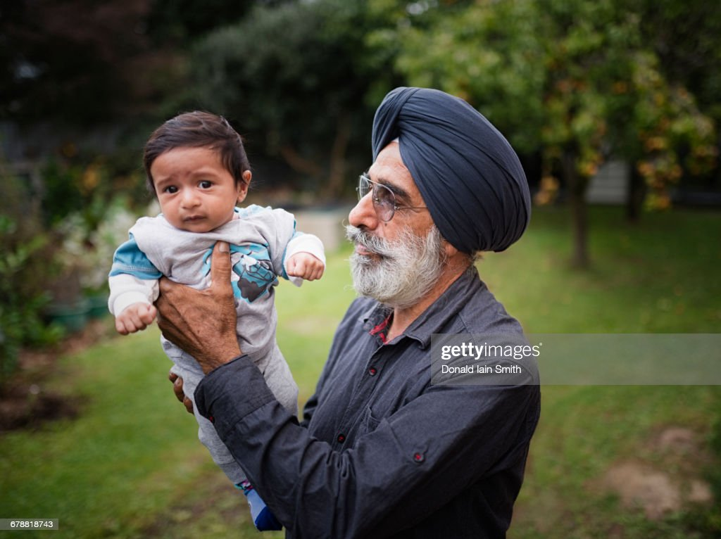 Indian grandfather holding baby grandson : Stock Photo