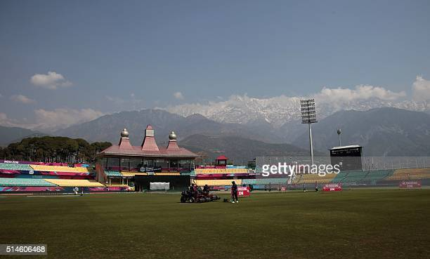 Indian groundstaff prepare the wicket at The Himachal Pradesh Cricket Association Stadium in Dharamsala on March 10 during the World T20 cricket...