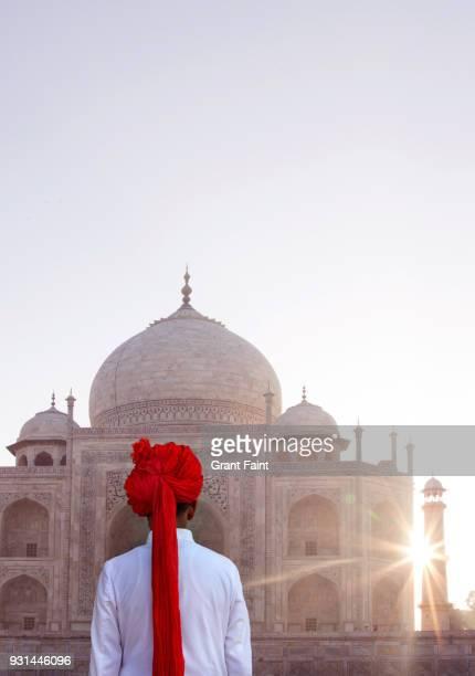 Indian guide enjoying sunrise at Taj Mahal