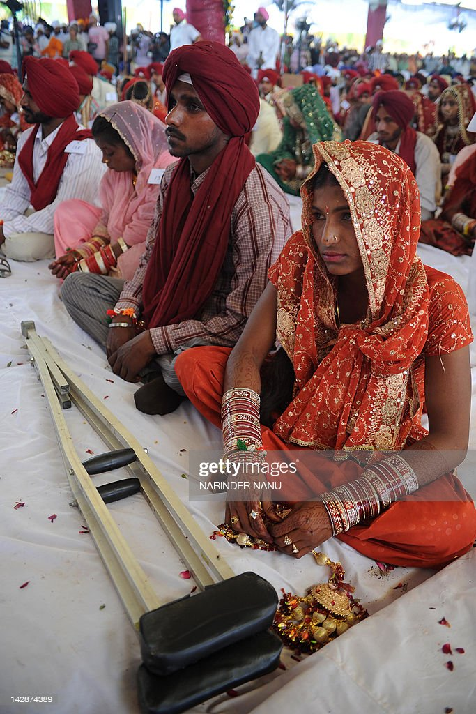 Indian handicapped bride Kawaljit Kaur sits with her handicapped groom Kuldeep Singh during a mass marriage ceremony for some 166 lowincome couples...