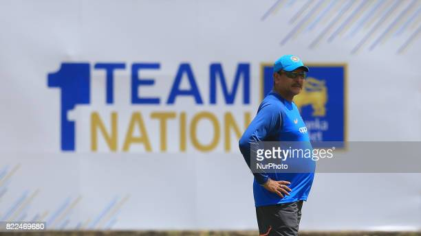 Indian head coach Ravi Shastri looks on during a practice session ahead of the 1st test match between Sri Lanka and India at Galle International...