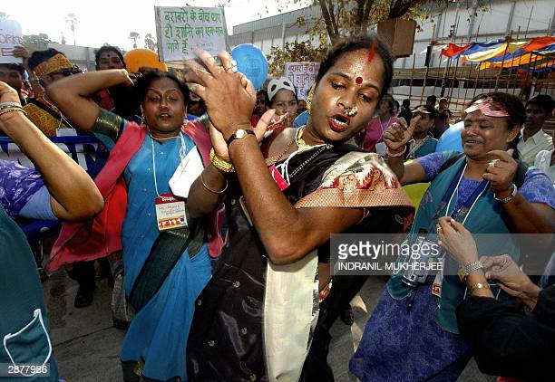Indian Hijra or transexual dances with fellow sex workers during a protest march of sex workers at the 2004 World Social Forum in Bombay 18 January...